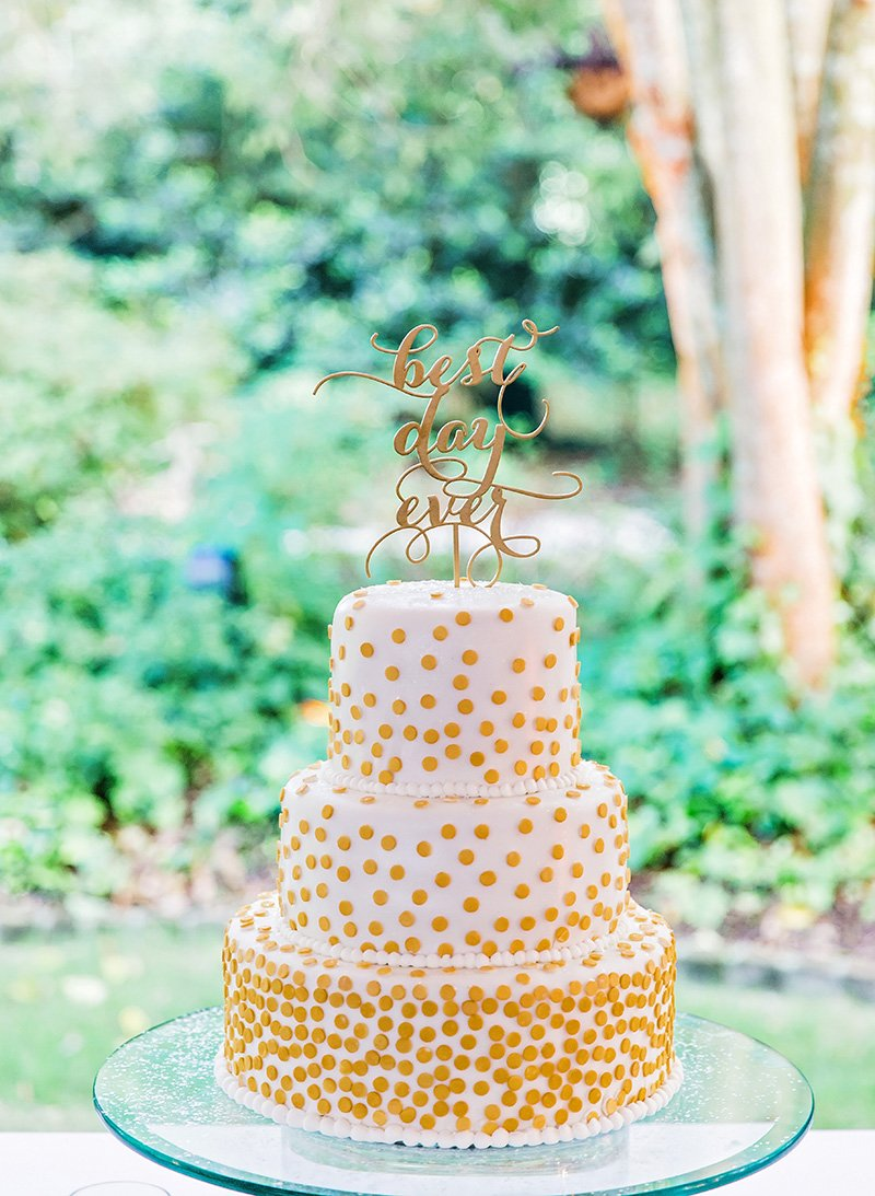 Wedding cake with gold cake topper Charleston wedding photographer Leah Marie Photography + Stationery