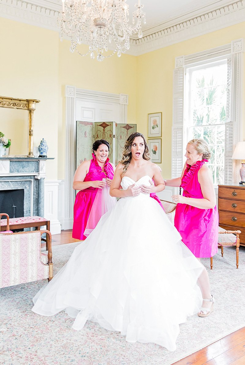 Bride getting ready with bridesmaids at Thomas Bennett House in Charleston Charleston wedding photographer Leah Marie Photography + Stationery