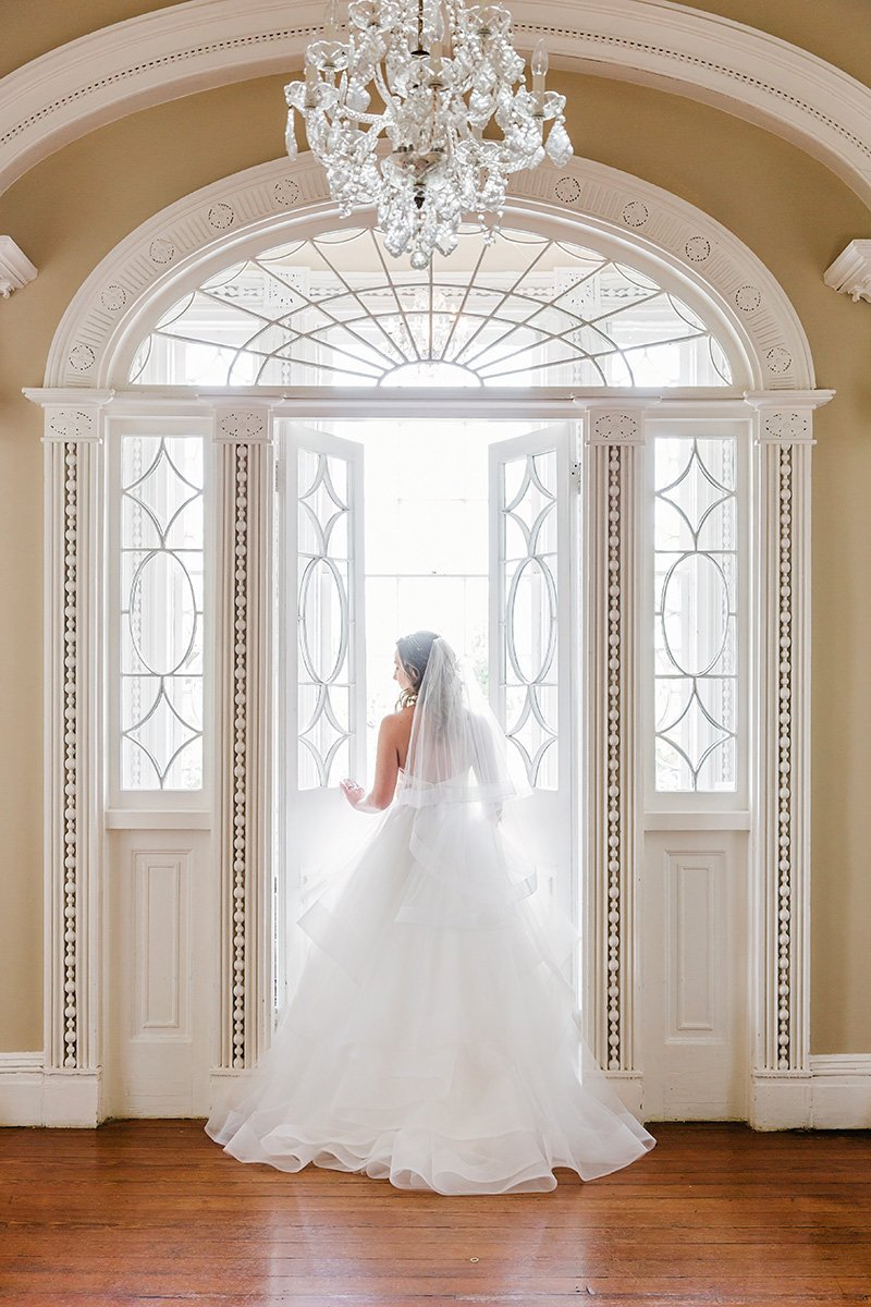 Bride in wedding dress at Thomas Bennett House in Charleston Charleston wedding photographer Leah Marie Photography + Stationery