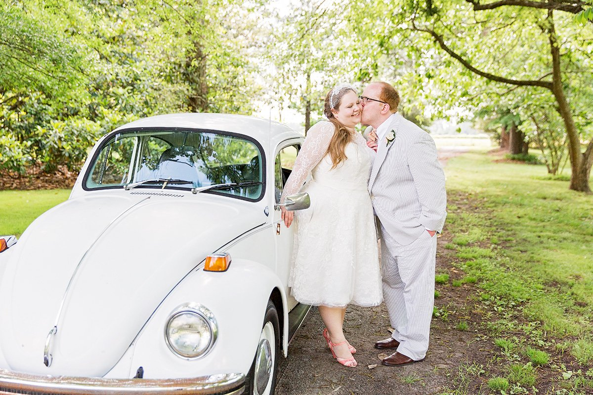 Bride and Groom with Volkswagen at farm wedding