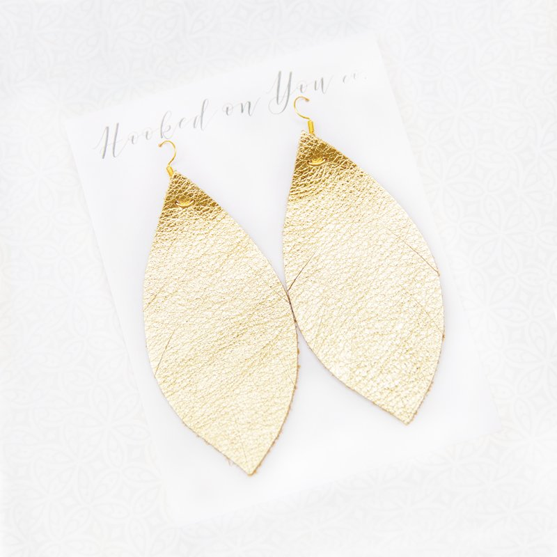 Leather feather earrings by Hooked on You co.