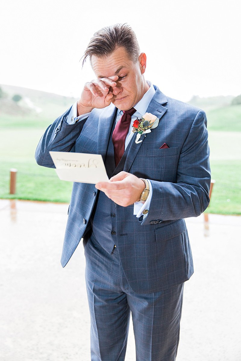 Groom reading love letter from bride San Jose wedding photographer Leah Marie Photography + Stationery