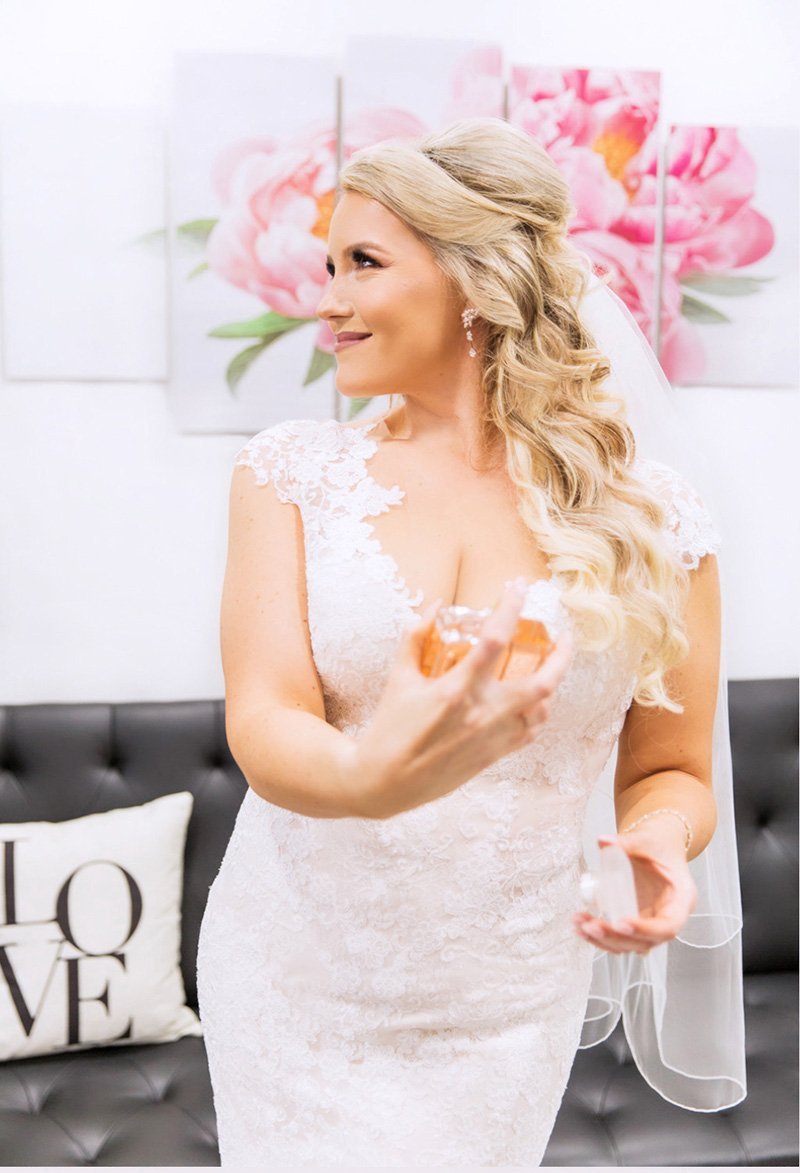 Bride holding Coco Chanel San Jose wedding photographer Leah Marie Photography + Stationery